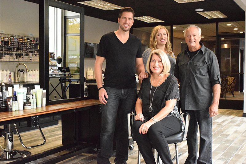 Daybreak Salon & Spa is owned by the Rushlow family, which includes Jerad Rushlow (left), Jenee Osborne, Gary Rushlow and Mary Toffoli Rushlow (front, center). Photo by Erica McClain